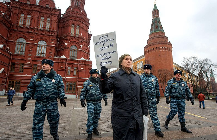 """""""No to military intervention in Crimea! Do not unleash a war!"""" - RUSSIA, Moscow - Russians protest to support Ukrainians in central Manezhnaya Square, March 2, 2014."""
